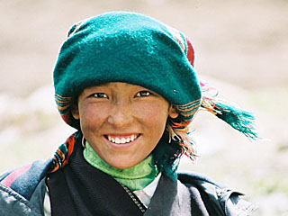 She is tibetan: she is buddhist: her thoughts, speachs and acts are pure, and you can read it in her eyes.