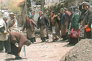 women dances in front of Yarto monastery street gate
